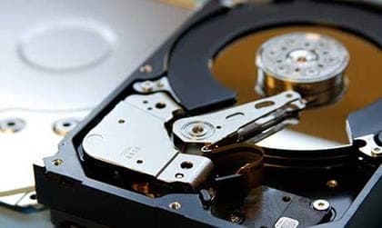 An open hard drive waiting for recovery